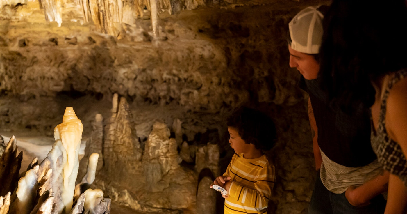 Myles Myrland, 4, looks at a stalagmite with his father Antonio Myrland while on a self-guided tour at Cave in the Mounds in Mount Horeb. (Photo © Andy Manis)
