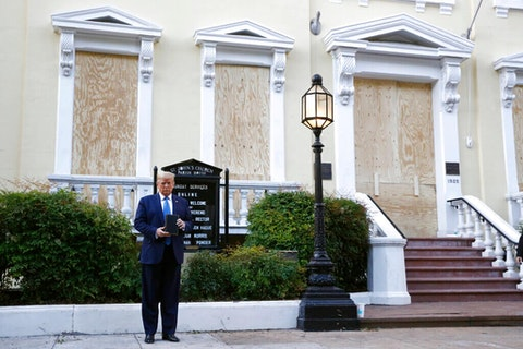 President Donald Trump holds a Bible after using tear gas to clear peaceful protestors from St. John's Church across from the White House on Monday, June 1, 2020, in Washington. (AP Photo/Patrick Semansky)