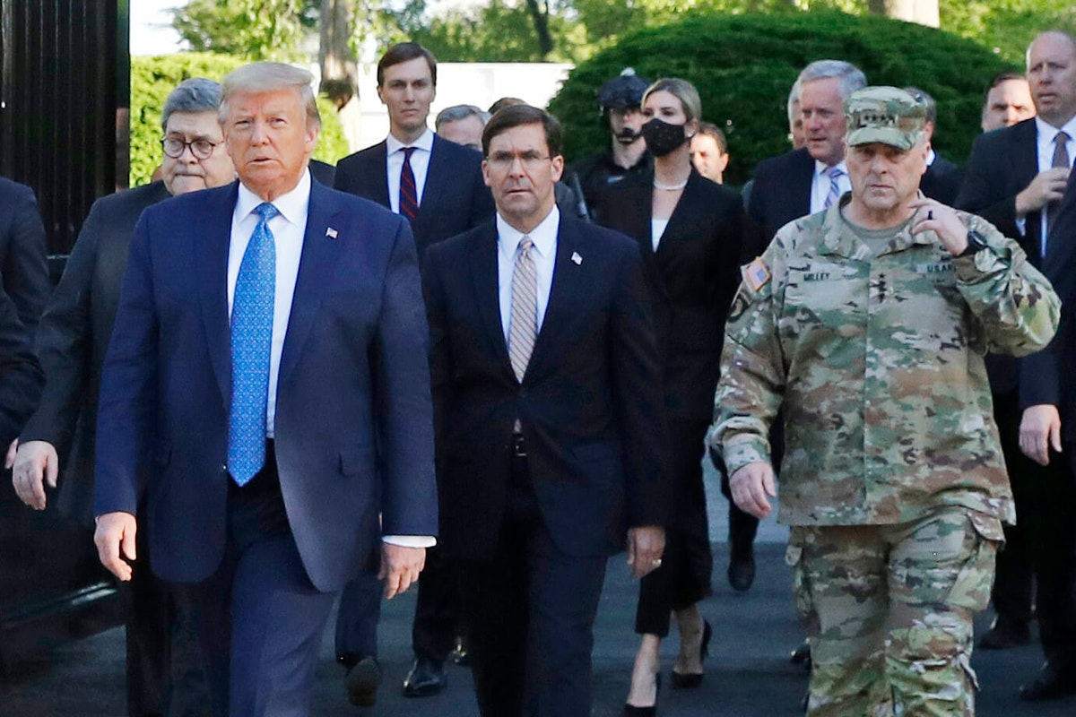 "FILE - In this June 1, 2020 file photo, President Donald Trump departs the White House to visit outside St. John's Church, in Washington. Part of the church was set on fire during protests on Sunday night. Walking behind Trump from left are, Attorney General William Barr, Secretary of Defense Mark Esper and Gen. Mark Milley, chairman of the Joint Chiefs of Staff.  Milley says his presence ""created a perception of the military involved in domestic politics."" He called it ""a mistake"" that he has learned from.  (AP Photo/Patrick Semansky)"