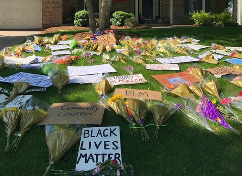 Protestors Lay Flowers, Black Lives Matter Signs on Dane County Sheriff's Lawn