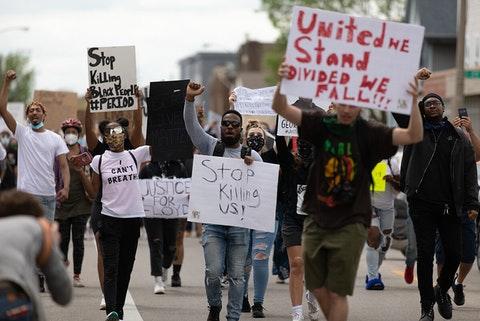 Demonstrators march through Milwaukee on May 29 to protest police brutality.