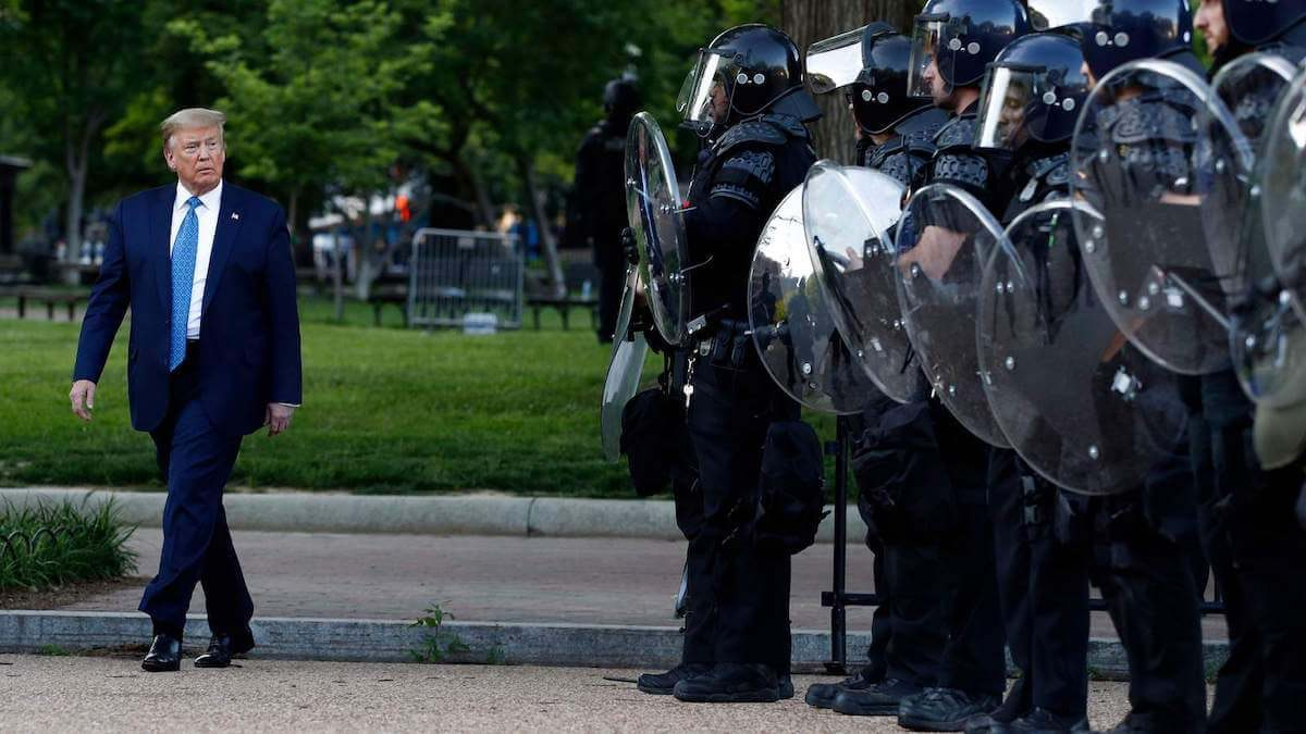 President Donald Trump walks past police in Lafayette Park after he visited outside St. John's Church across from the White House Monday, June 1, 2020, in Washington. Part of the church was set on fire during protests on Sunday night. (AP Photo/Patrick Semansky) (Copyright 2020 The Associated Press. All rights reserved.)