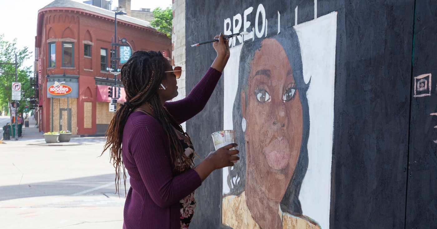 A mural in memory of Breonna Taylor is being painted on a State Street store front. Gov. Tony Evers and Lt. Gov. Mandela Barnes introduced a package of bills in June that would ban no-knock search warrants. Taylor was shot by police after they entered her Louisville home with that type of warrant. (Photo by Lola Abu)