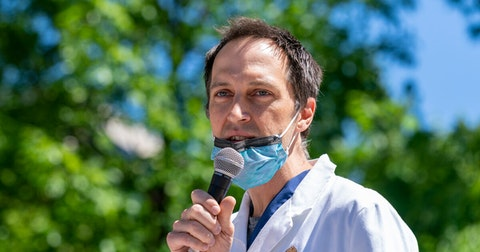 "Dr. Ryan Westergaard, chief medical officer for the state of Wisconsin,  said Tuesday during a press briefing that ""we really need to take the risk seriously that this progress can be undone because of novel variants."" He is pictured at a June White Coats for Black Lives rally in Madison. (Photo © Andy Manis)"