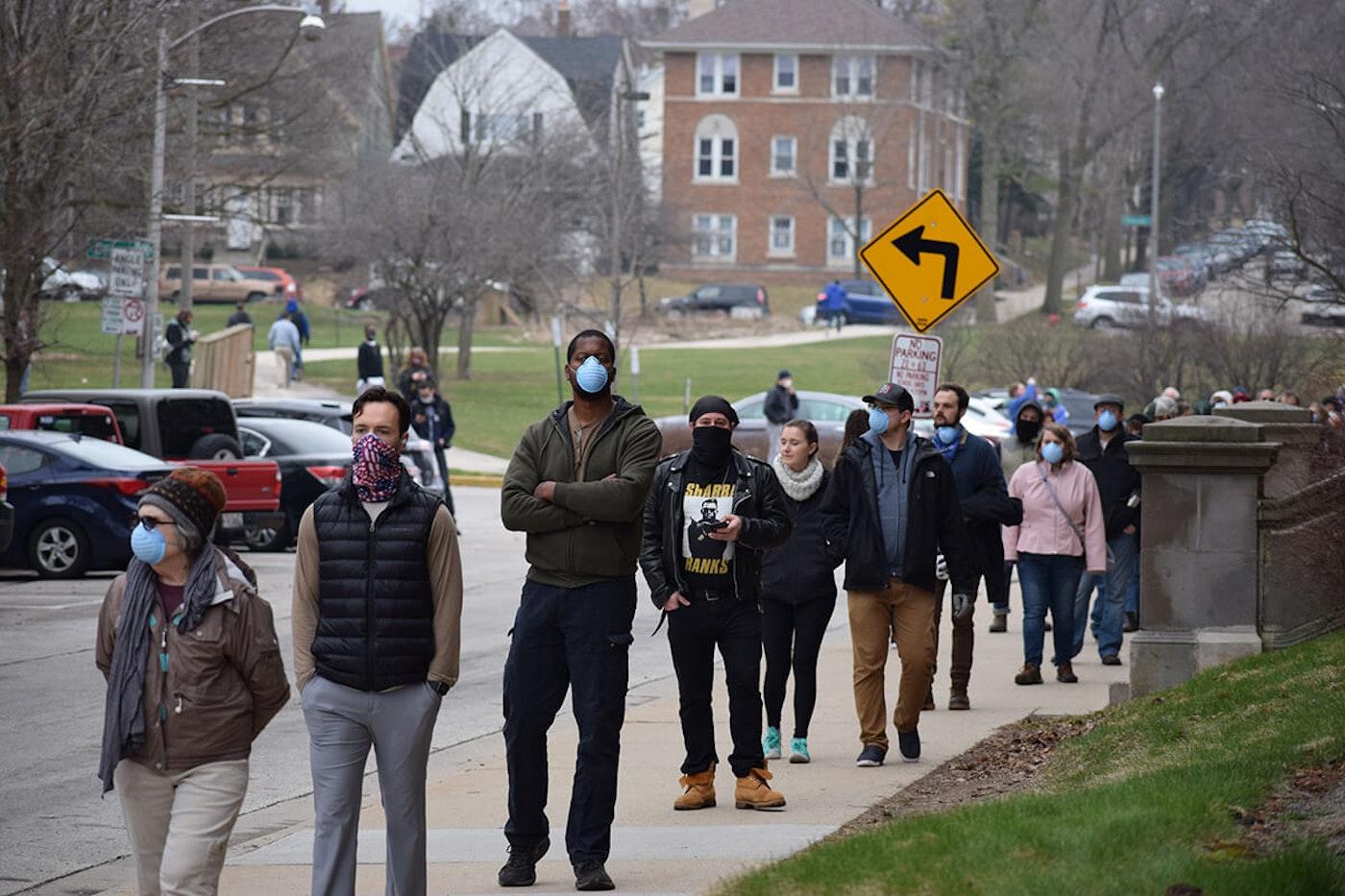 Voters wait in line on April 7 outside Riverside High School in Milwaukee. (Photo by Jonathon Sadowski)