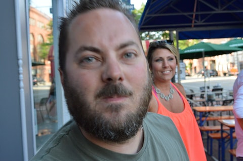 Off-duty Milwaukee Police Officer Matthew Willmann approaches photographer LaTasha Lux before striking her on July 5.