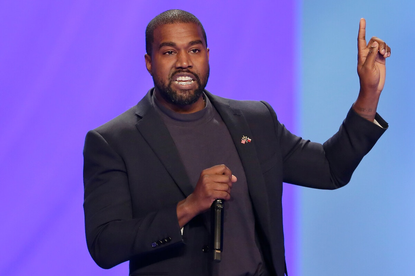 FILE - Kanye West answers questions during a church service, Nov. 17, 2019, in Houston, TX.