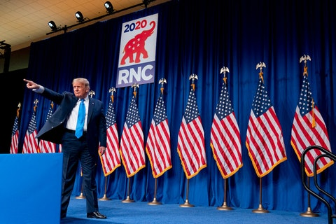 President Donald Trump stands on stage during the first day of the 2020 Republican National Convention in Charlotte, N.C., Monday, Aug. 24, 2020.