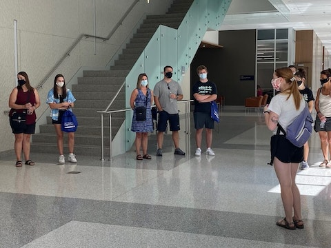 Prospective UW-Eau Claire students tour campus Friday, wearing masks to prevent the spread of COVID-19. Masks will be required of students and faculty on campus when classes begin at the university and other UW System campuses in two weeks.