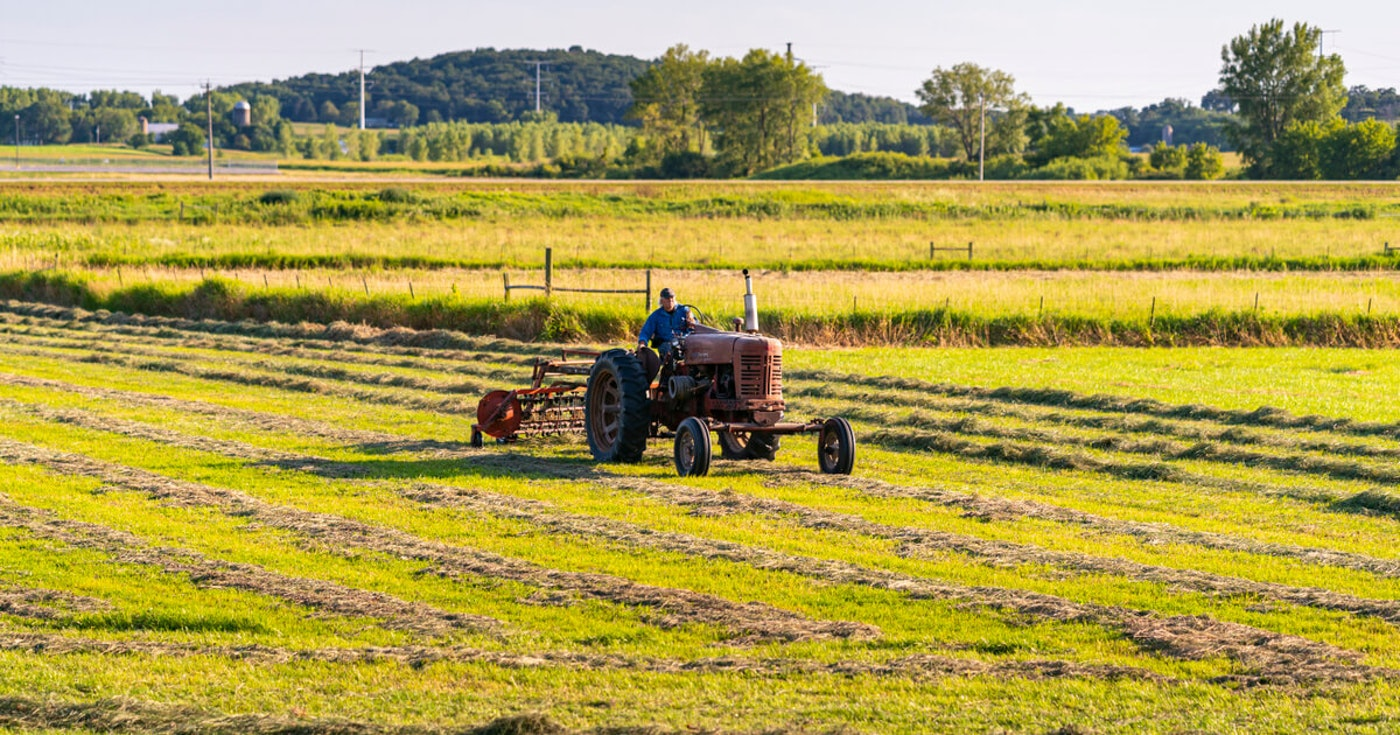A Wisconsin farmer works his field outside Marshall in early August. (Photo © Andy Manis)