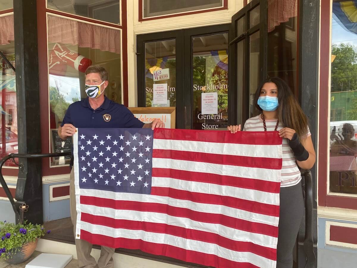 U.S. Rep. Ron Kind, a La Crosse Democrat, presents an American flag to Lily Stegemann that Kind had flown above the U.S. Capitol in Washington, D.C., in Stegemann's honor.