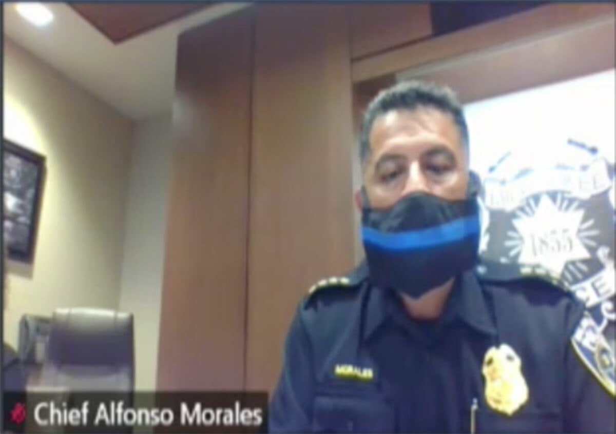 """Milwaukee Police Chief Alfonso Morales, clad in a """"thin blue line"""" face mask, watches over Zoom Thursday night as the city's Fire and Police Commission votes to demote him to captain. (Screenshot/City of Milwaukee)"""