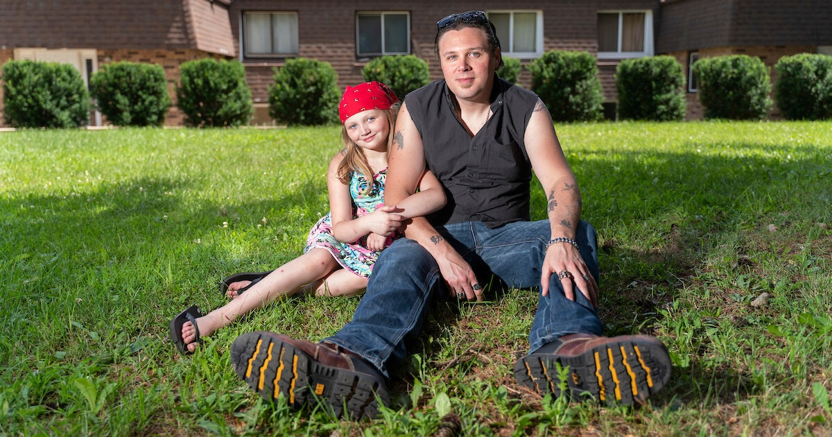 Joshua Crouse and his 10-year-old daughter, Marley, sit outside their Janesville apartment at the end of July. Crouse is among thousands of Wisconsin residents struggling to pay rent each month because of the economy during the pandemic. (Photo © Andy Manis)