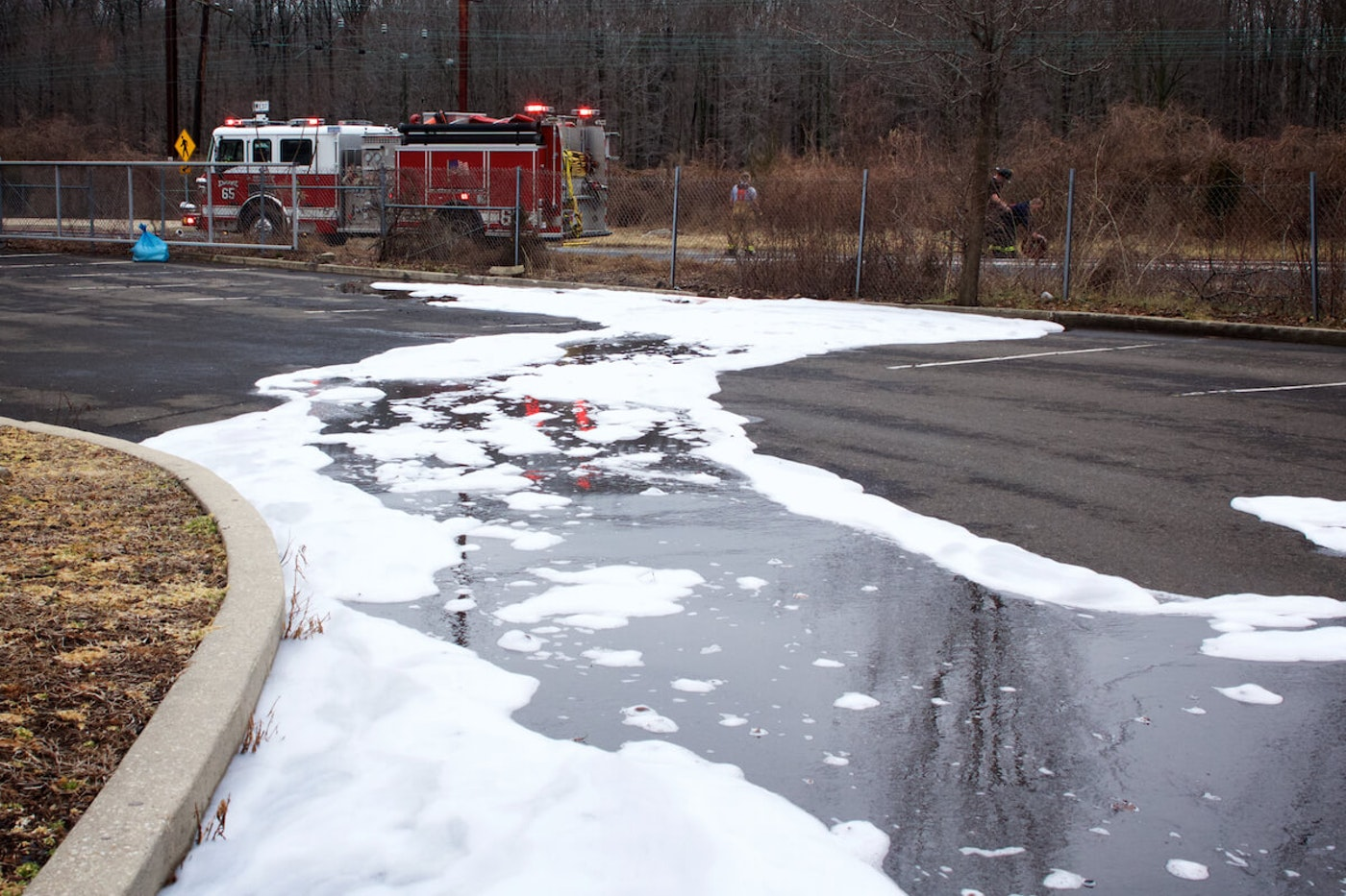 Bensalem, Pennsylvania / USA - February 7, 2019: Firefighting foam remains on the ground surface following a tanker truck accident.