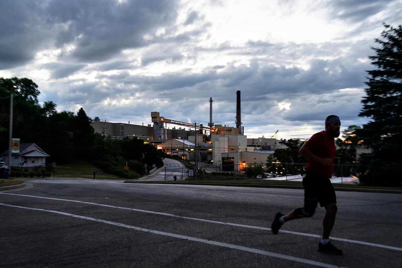 A jogger runs past the Midwest Paper Group mill in Combined Locks