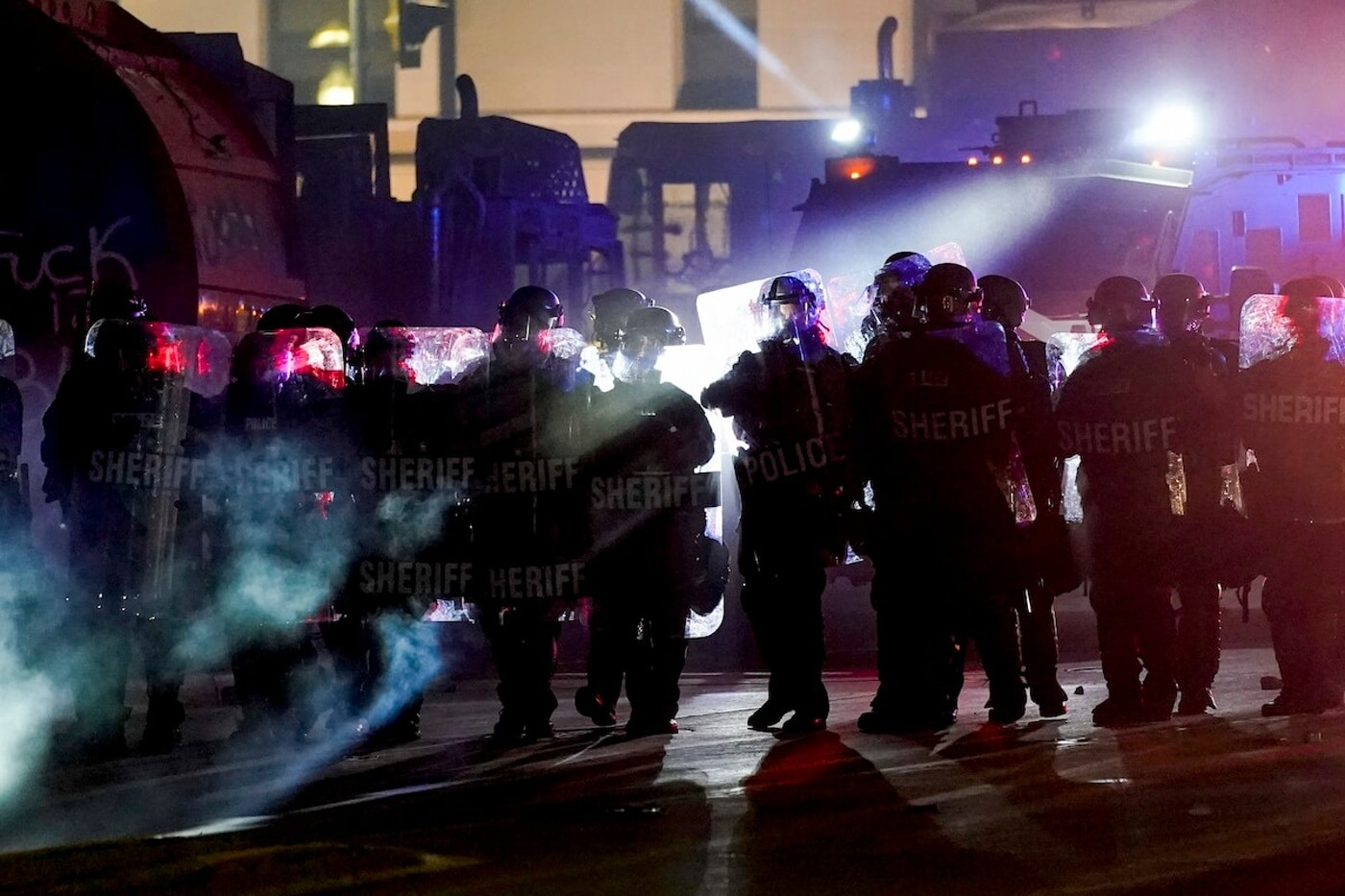 Authorities disperse protesters out of a park Tuesday, Aug. 25, in Kenosha. (AP Photo/Morry Gash)