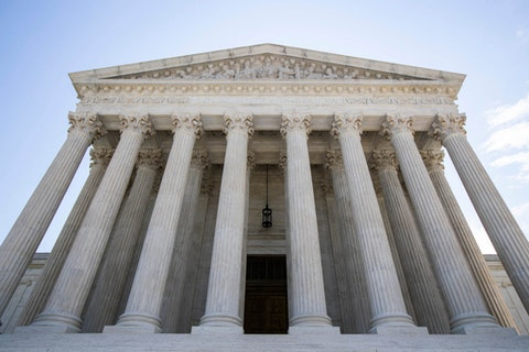 The U.S. Supreme Court as seen Tuesday, June 30 in Washington. (AP Photo/Manuel Balce Ceneta)