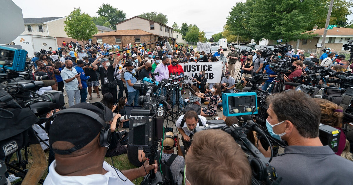 Despite President Donald Trump's impending arrival to Kenosha, the Justice for Jacob Blake Celebration drew the attention of national and international media. Here, the Rev. Jesse Jackson and Blake's uncle, Justin Blake (red shirt) address the press. (Photo © Andy Manis)