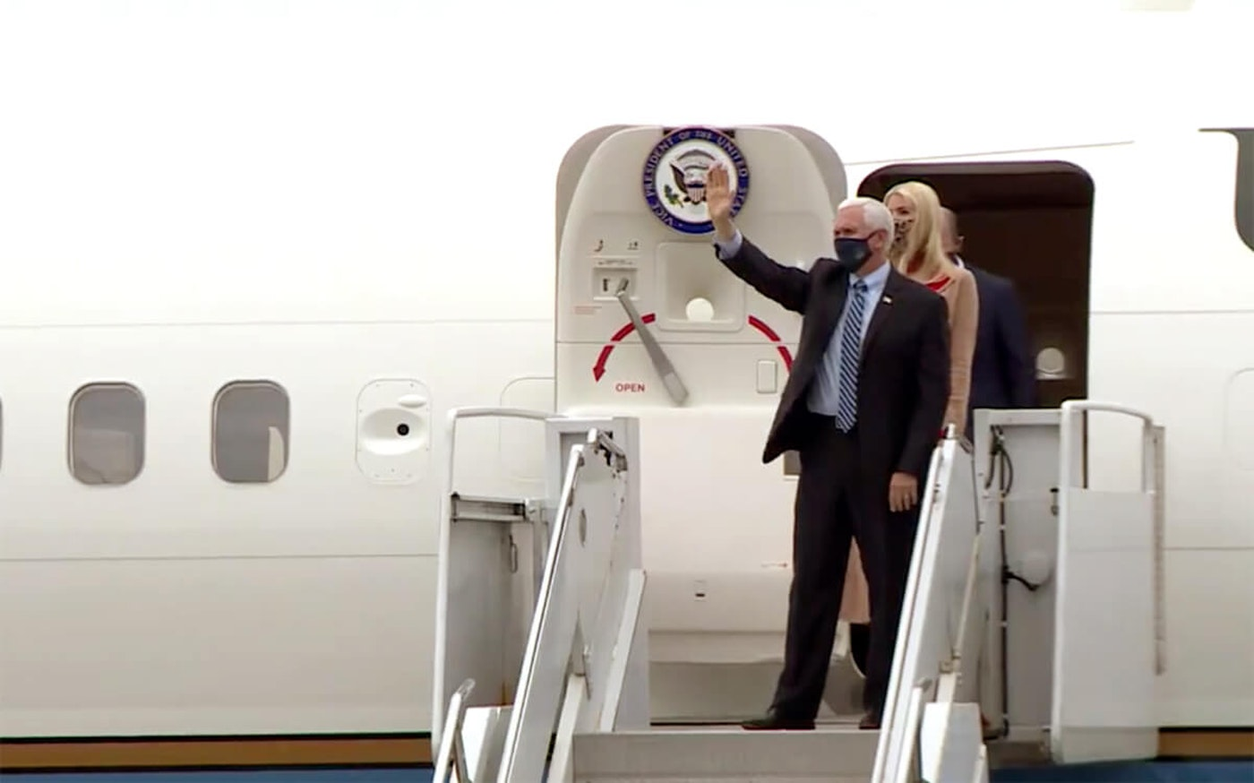Vice President Mike Pence exits Air Force Two on Thursday in Eau Claire.