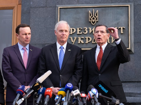 U.S. Senators Chris Murphy, Ron Johnson and John Barrasso during a news briefing following their meeting with Ukrainian President Volodymyr Zelenskiy in Kyivv, Ukraine, February 14, 2020.