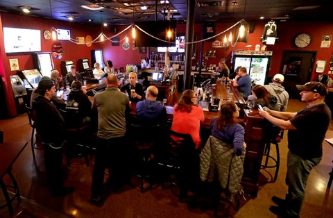 The Dairyland Brew Pub opens to patrons in Appleton. A Wisconsin judge on Monday, Oct. 19, reimposed an order from Gov. Tony Evers' administration limiting the number of people who can gather in bars, restaurants and other indoor venues to 25% of capacity. That decision was overturned Friday. (William Glasheen/The Post-Crescent via AP File)