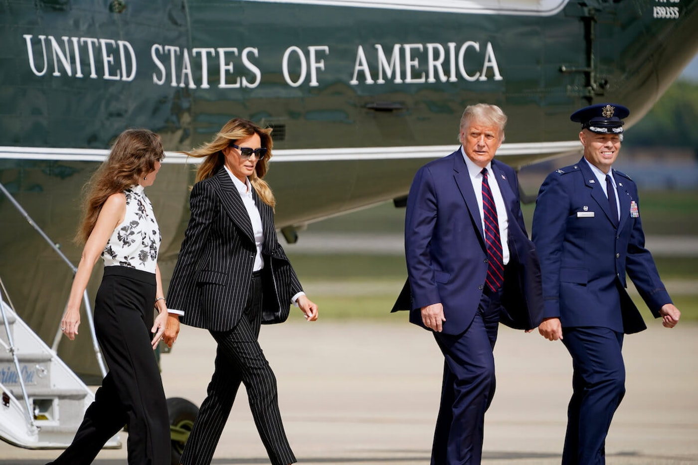 President Donald Trump and first lady Melania Trump walk to board Air Force One to travel to the first presidential debate in Cleveland, Tuesday, Sept. 29, 2020, in Andrews Air Force Base, Md.
