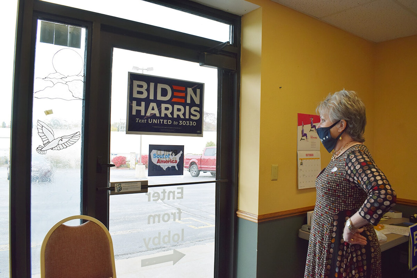 Deb Dassow, chairwoman of the Ozaukee County Democratic Party, gives a tour of the party's first-ever field office several days before Election Day in downtown Grafton. (Photo by Jonathon Sadowski)