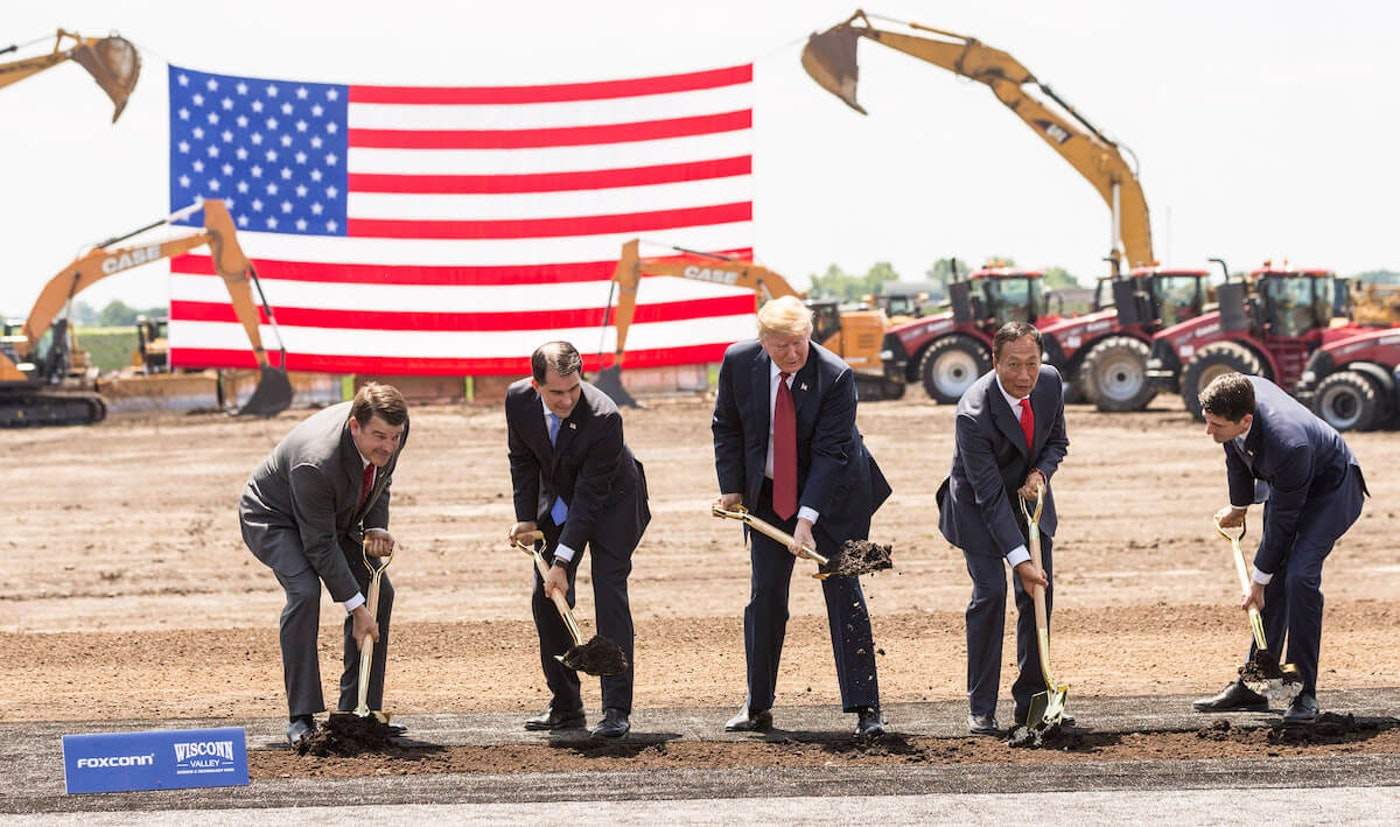 """President Donald Trump breaks ground with former Gov. Scott Walker (2nd L), Foxconn CEO Terry Gou (2nd R), former U.S. House Speaker Paul Ryan (R-WI) (R) and Christopher """"Tank"""" Murdock (L), the first Wisconsin Foxconn employee, at a ceremony for the Foxconn Technology Group computer screen plant on June 28, 2018, in Mount Pleasant, Wisconsin. Foxconn had committed to build a $10 billion plant in what it has named the Wisconn Valley Science and Technology Park, and to create 13,000 Wisconsin jobs. That has not yet happened. (Photo by Andy Manis/Getty Images)"""