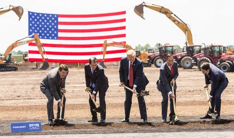 "President Donald Trump breaks ground with former Gov. Scott Walker (2nd L), Foxconn CEO Terry Gou (2nd R), former U.S. House Speaker Paul Ryan (R-WI) (R) and Christopher ""Tank"" Murdock (L), the first Wisconsin Foxconn employee, at a ceremony for the Foxconn Technology Group computer screen plant on June 28, 2018, in Mount Pleasant, Wisconsin. Foxconn had committed to build a $10 billion plant in what it has named the Wisconn Valley Science and Technology Park, and to create 13,000 Wisconsin jobs. That has not yet happened. (Photo by Andy Manis/Getty Images)"