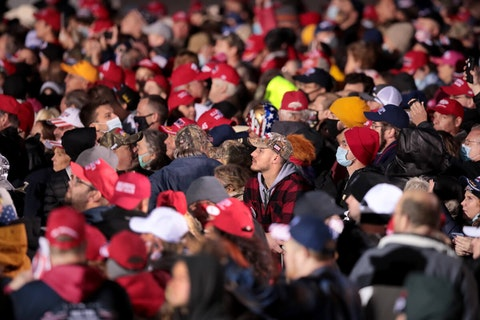 Supporters of President Donald Trump pack together at a campaign rally at the Southern Wisconsin Regional Airport on October 17, 2020 in Janesville, Wisconsin.