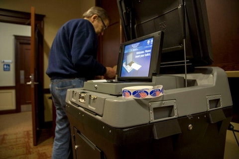 A voter in Wauwatosa casts a ballot on November 6, 2018. (Photo by Darren Hauck/Getty Images)