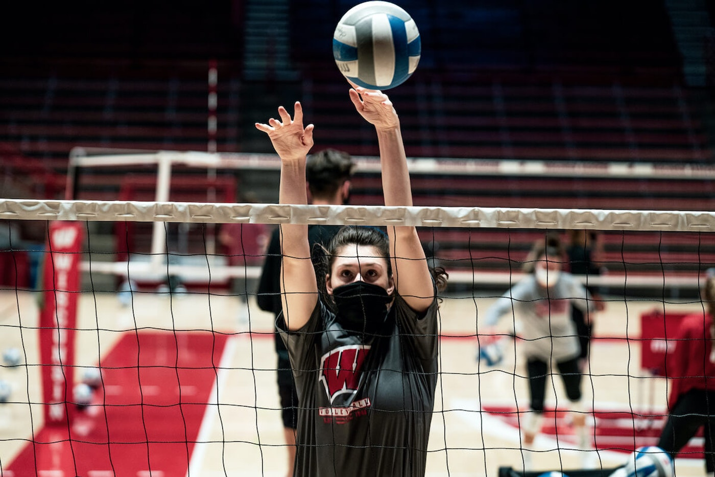 Wisconsin volleyball player Dana Rettke goes up for a block during a Badgers practice at the UW Field House. Rettke, a senior three-time All-American, would have competed with the U.S. national team over the summer in hopes of earning a spot on the U.S. Olympic team. (Photo by Bianca Miceli for UW Athletics)