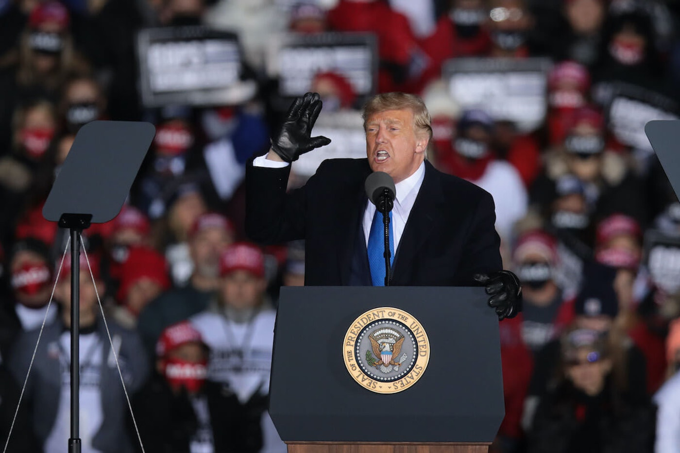 President Donald Trump speaks to supporters during a campaign rally at the Waukesha County Airport Oct. 27. During the rally, he continued to  spread a lie that the medical field is overreporting and financially benefiting from COVID-19 deaths. Neither claim is true.(Photo by Scott Olson/Getty Images)