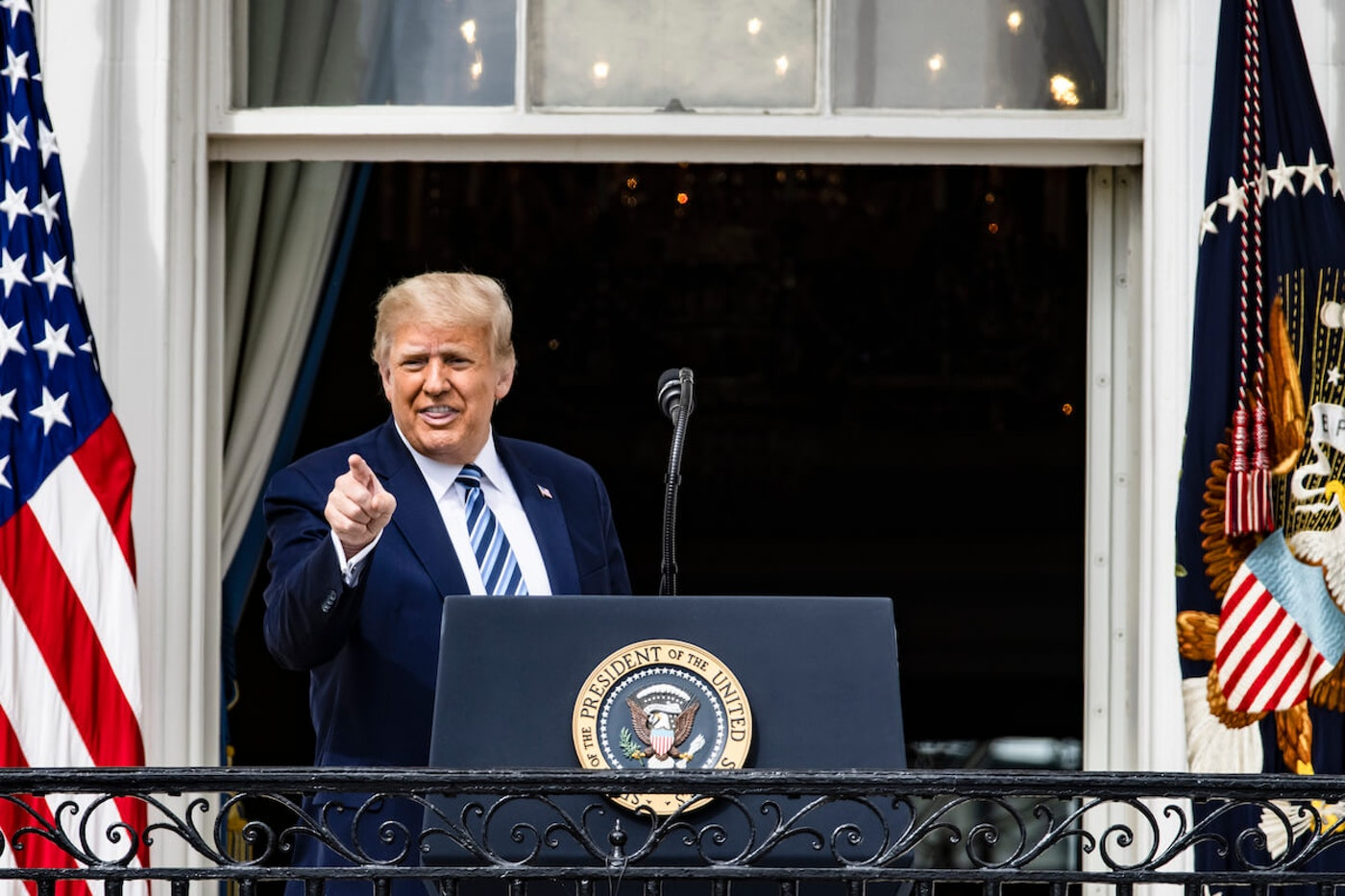 President Donald Trump addresses a crowd on the South Lawn of the White House Saturday. This was the president's first in-person appearance after being cleared by his doctors following his diagnosis and treatment of the coronavirus. (Photo by Samuel Corum/Getty Images)
