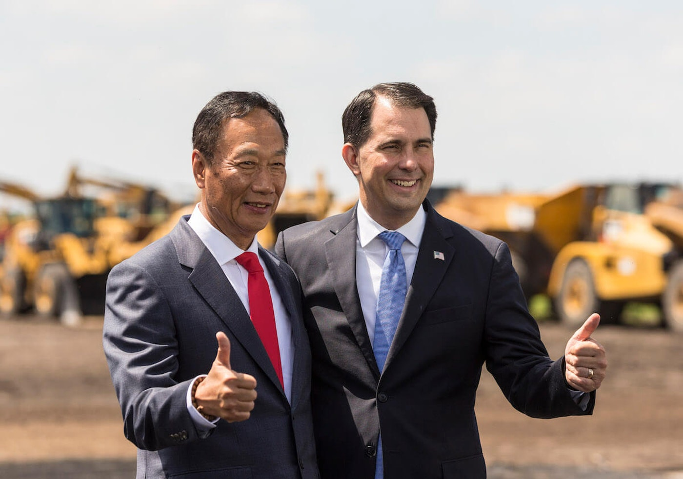 Foxconn CEO Terry Gou and former Gov. Scott Walker pose for photos before the groundbreaking of the Foxconn Technology Group computer screen plant on June 28, 2018, in Mount Pleasant. President Donald Trump also attended the event. Foxconn had committed to building a $10 billion plant and creating 13,000 Wisconsin jobs. Two years later, neither has happened. (Photo by Andy Manis/Getty Images)