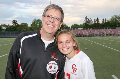 Chippewa Falls High School teacher Warren Bowe is recognized by student and soccer player Hazel Behling during the soccer team's teacher appreciation day ceremony in May 2017. Behling was one of many students who valued Bowe as a mentor before he retired at the end of last school year. (Photo courtesy of Hazel Behling)