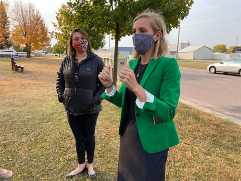 Eau Claire City Council member Kate Beaton, left, listens to State Treasurer Sarah Godlewski during a recent affordable housing discussion in Eau Claire. Beaton is among Wisconsin elected officials who have received threatening messages as they have considered COVID-19 regulations intended to slow the spread of the virus. (Photo by Julian Emerson)