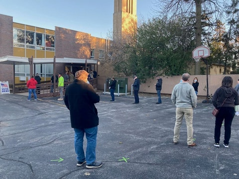 Outside the Emmanuel United Methodist Church in Appleton, the line of social-distanced voters winds around the parking lot at 4 p.m. on Election Day.