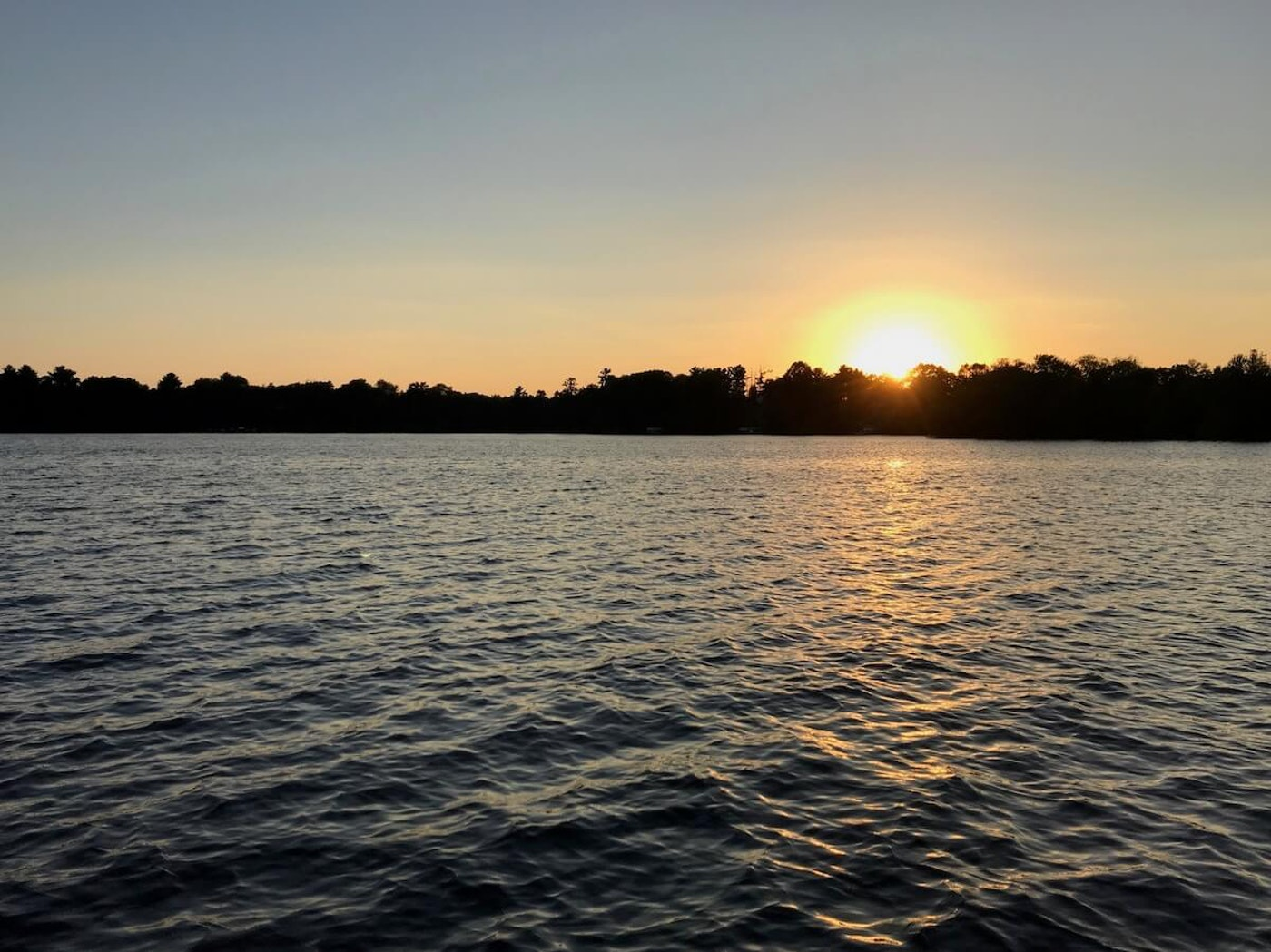 Few things can melt away life's daily challenges and spark gratitude quite like being on Lake Wissota at sunset. (Photo by Pat Kreitlow)