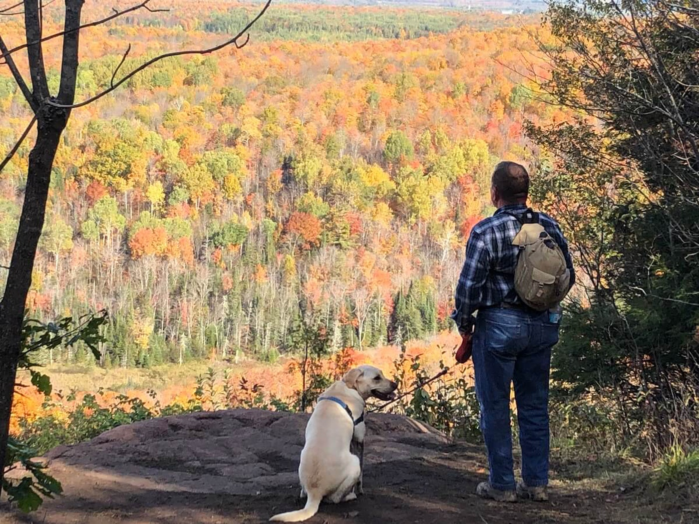 Darla Dernovsek submitted this photo of her husband Mike and their dog Sunny on a hike at St. Peter's Dome near Ashland.
