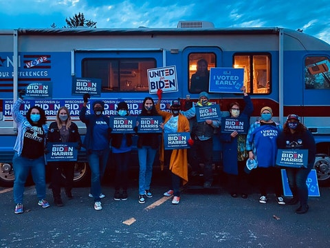 Members of Persist: Progressive Women Activists of Washington County pose for a photo after a pop-up event on Oct. 21 in West Bend. The group formed in May to mobilize Democratic women in the suburban county. (Photo courtesy of Patti Silverman)