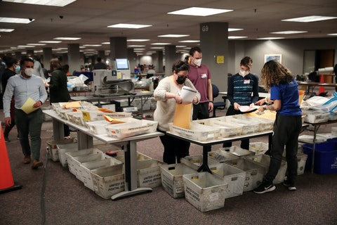Election officials count absentee ballots on Nov. 4 Milwaukee. Wisconsin requires election officials to wait to begin counting absentee ballots until after polls open on election day. The Milwaukee count was finished about 3 a.m.(Photo by Scott Olson/Getty Images)