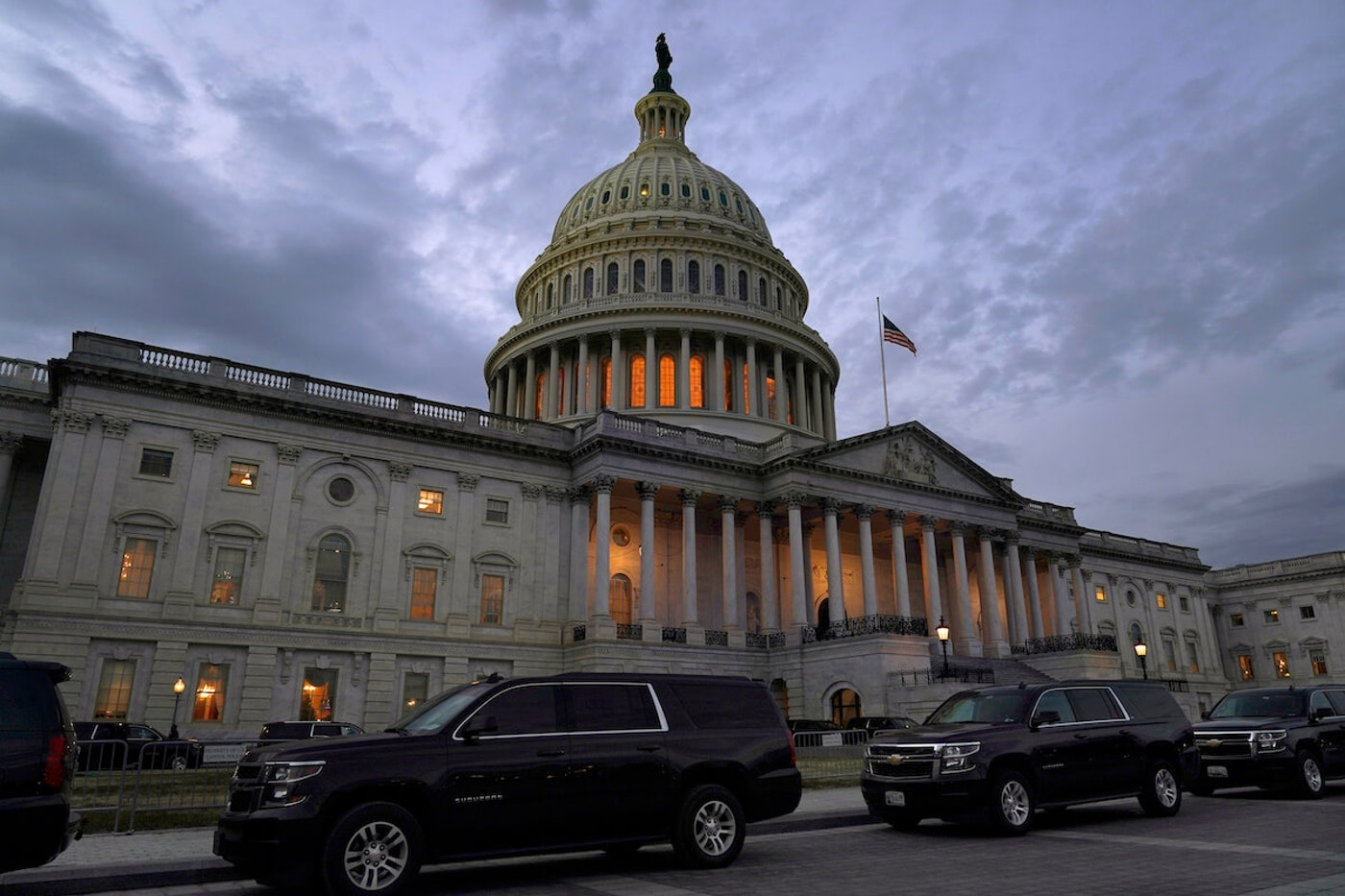 Dusk falls over the Capitol Monday after Congressional leaders have hashed out a massive, year-end catchall bill that combines $900 billion in COVID-19 aid with a $1.4 trillion spending bill and reams of other unfinished legislation on taxes, energy, education and health care. (AP Photo/Jacquelyn Martin)