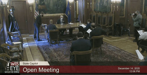 Wisconsin delegates pledged to President-elect Joe Biden sit socially distanced during vote of the Electoral College  Monday in the state Capitol in Madison. (Screen image from WisconsinEye)