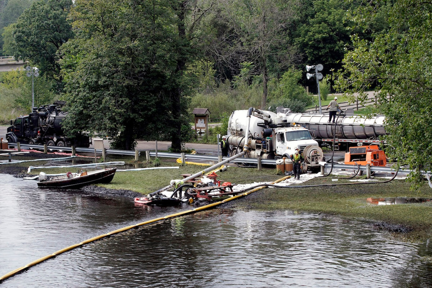 Concerns about a proposed pipeline include potential spills, such as this July 2010 oil spill of approximately 840,000 gallons of crude oil into the Kalamazoo River in Battle Creek, Michigan, from a 30 inch-wide pipeline owned by Enbridge Energy Partners. (Photo by Bill Pugliano/Getty Images)