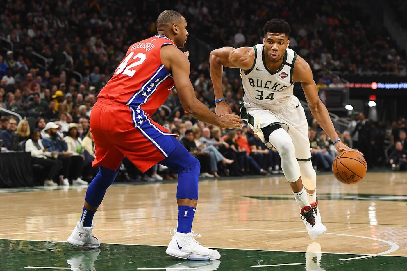 Giannis Antetokounmpo, #34 of the Milwaukee Bucks, is defended by Al Horford #42 of the Philadelphia 76ers during a game at Fiserv Forum on February 22, 2020 in Milwaukee.  (Photo by Stacy Revere/Getty Images)