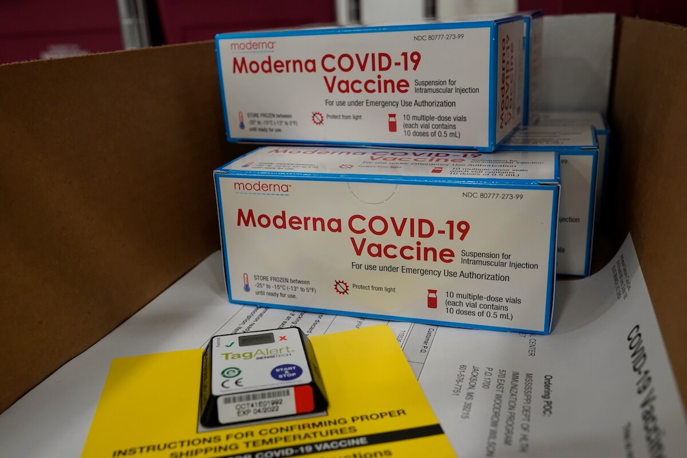 Boxes containing the Moderna COVID-19 vaccine are prepared to be shipped at the McKesson distribution center in Olive Branch, Mississippi. The federal government plans to distribute over the coming week a total of 7.9 million doses of vaccines from Moderna and Pfizer Inc. (Photo by Paul Sancya - Pool/Getty Images)