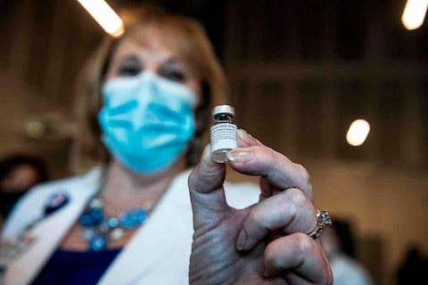 A healthcare worker holds a Pfizer-BioNtech Covid-19 vaccine at Memorial Healthcare System, in Miramar, Florida on December 14, 2020. - The United States kicked off a mass vaccination drive Monday hoping to turn the tide on the world's biggest coronavirus outbreak, as the country's death toll neared a staggering 300,000. (Photo by CHANDAN KHANNA/AFP via Getty Images)