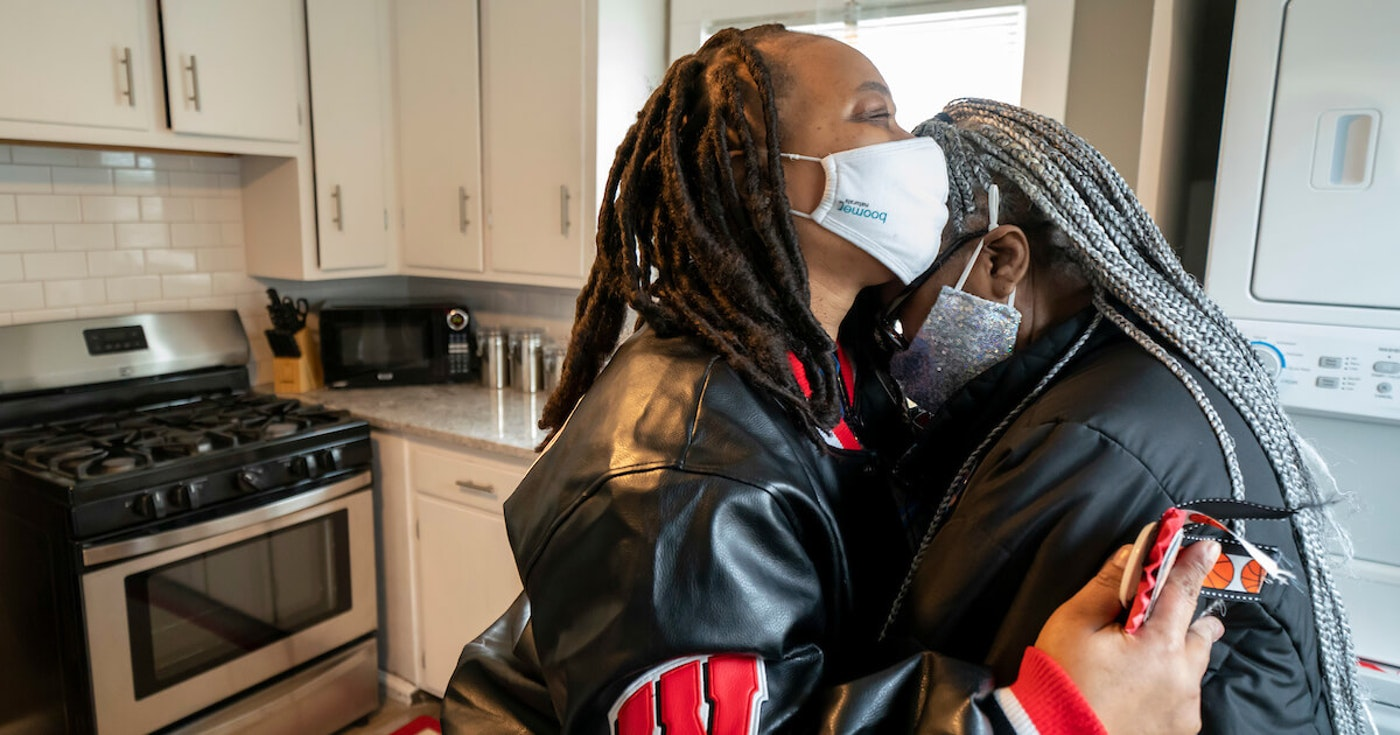 """Lorene Gomez hugs her mother, Irene """"GG"""" Alexander, in the newly renovated kitchen in GG's Madison home on Dec. 18. (Photo © Andy Manis)"""