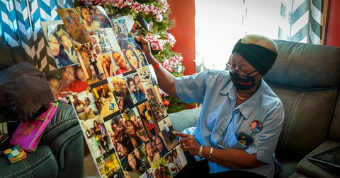Irene Alexander holds a collage of photos of her great-granddaughter Anisa Scott at her home Tuesday. A community call to action led by the Boys & Girls Club of Dane County is renovating Alexander's home in time for the holidays. (Photo © Andy Manis)